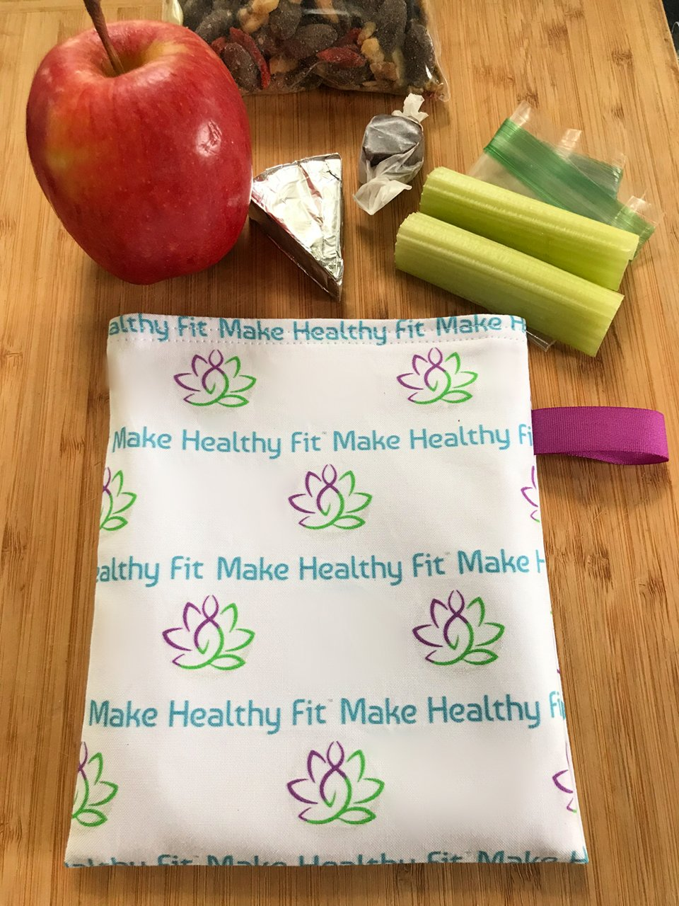 Snack bag laid out on table with sample snacks.